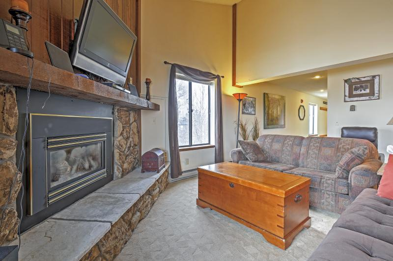 Cozy up by the gas fireplace while watching your favorite show on the flat screen TV