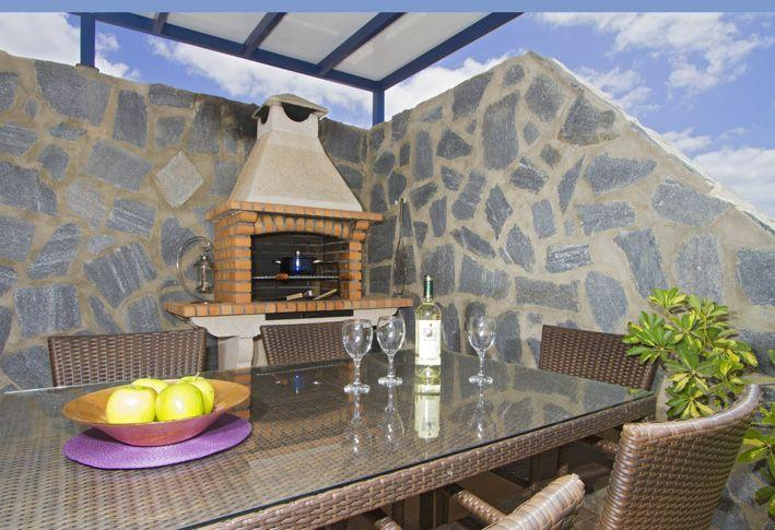 BBQ area under covered terrace with easy access to kitchen