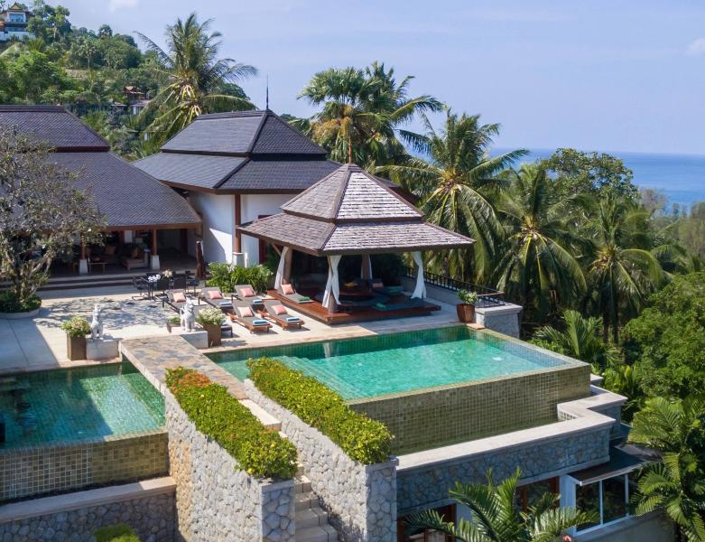 Beautiful Villa Sanyanga has views of the ocean on two sides and is surrounded by coconut palms