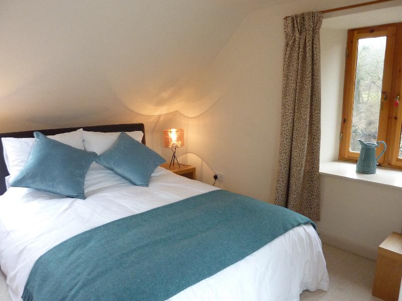 King-sized bed in the Loft: made up with feather duvet and crisp cotton bed-linen
