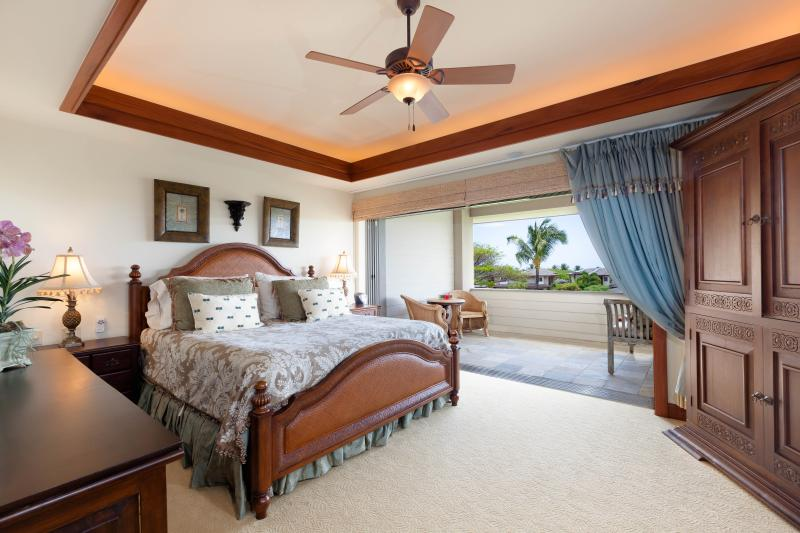 Master bedroom with retractable doors and large lanai.