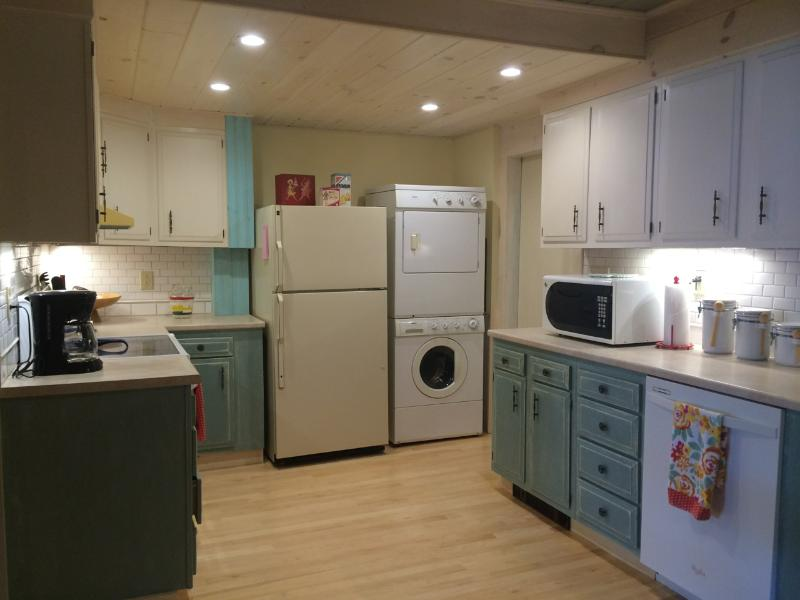 Large kitchen with all convenient appliances & washer / dryer