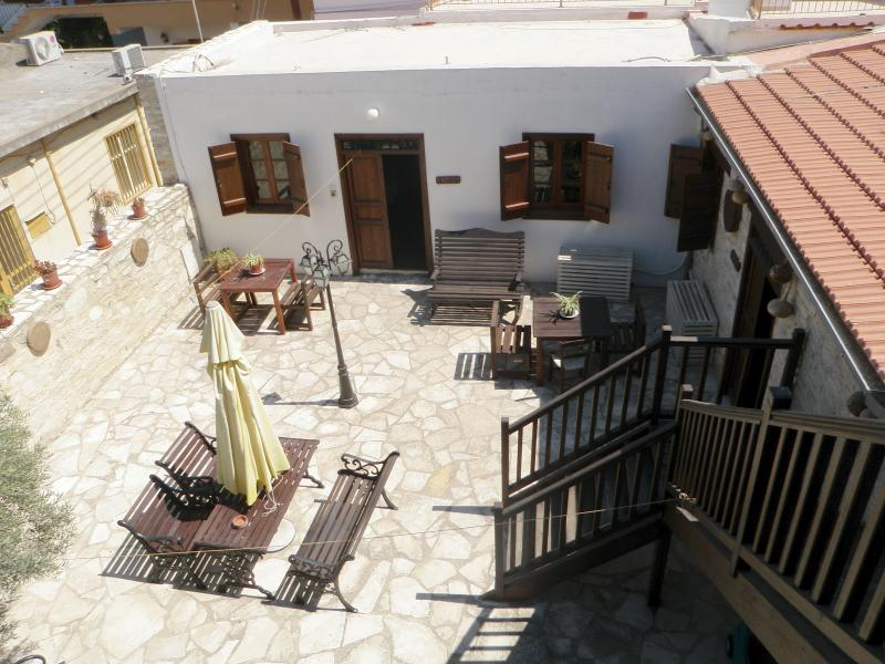 Section of Romios Apartments Yard, perfect to relax with a glass of local wine and a good book