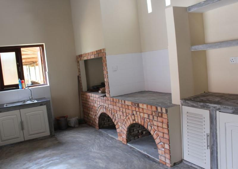 A fully equipped kitchen with modern amenities await guests to Hilltop View.