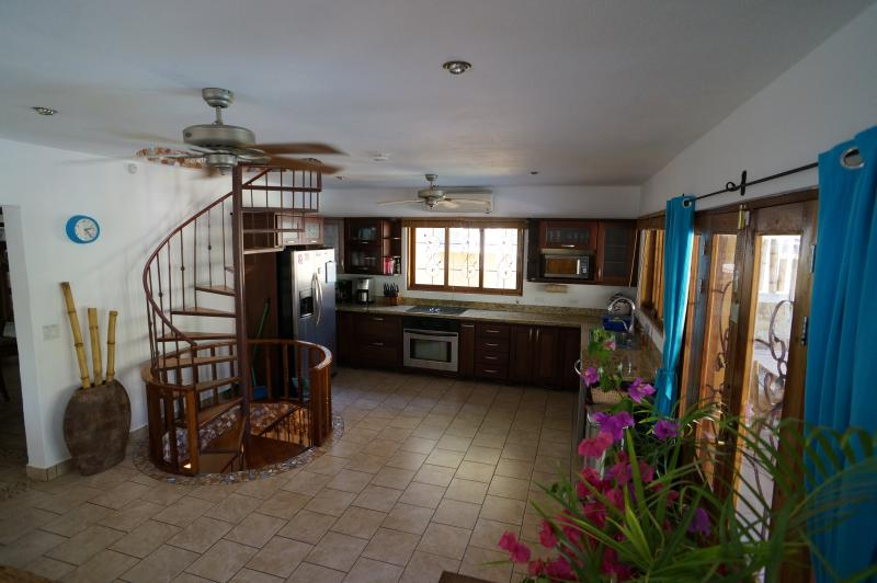 Kitchen with high end appliances & large stove