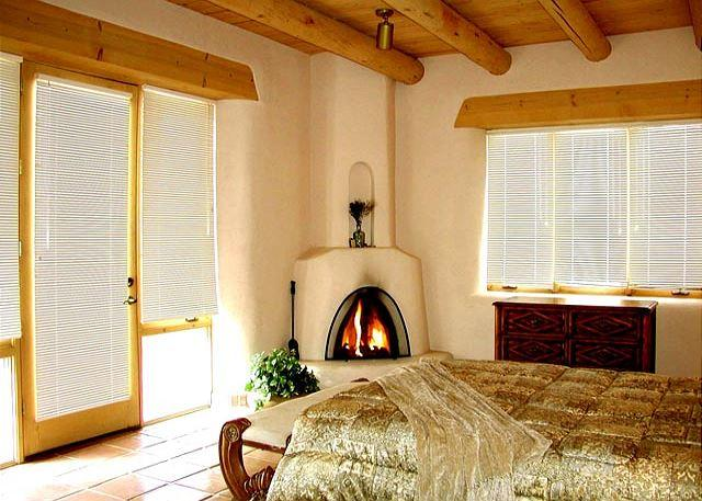 Master bedroom with King and wood burning kiva fireplace