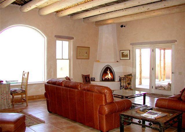 Glorious mountain views + Living Room Kiva Fireplace