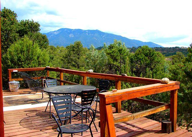 Private south facing deck offers sweeping mountain and valley views