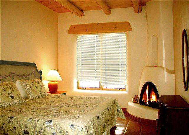 King or 2 twins guest bedroom + wood burning kiva fireplace