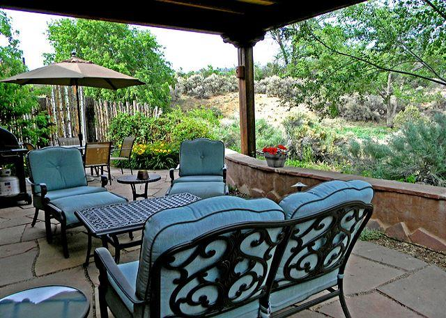 Lush landscaped portal for morning coffee, evening socializing or silent relaxation