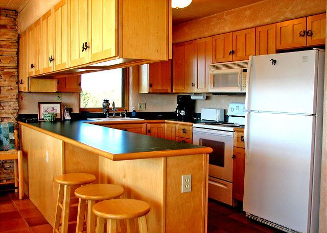 Fully equipped kitchen included dishwasher, breakfast bar & open expansive views