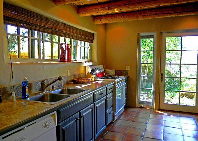 Tasteful upgraded kitchen with floor to ceiling view door and windows