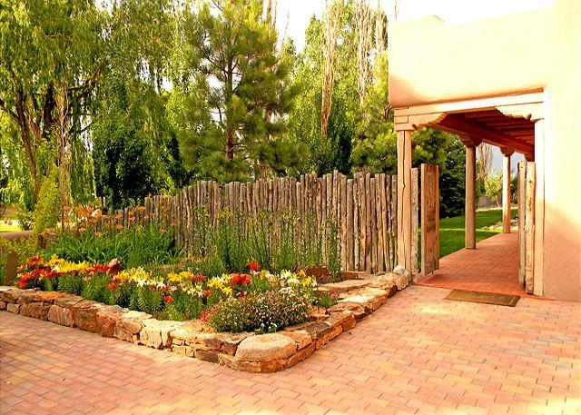 The open gate French Door entry is only the beginning of the lush garden landscaping throught Garden Oasis