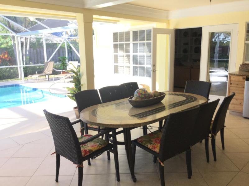 Designer decorated home just steps from the beach. Enjoy eating poolside  on beautiful Patio.