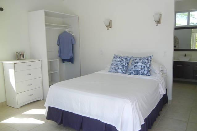 Master bedroom with queen sized bed and en-suite bathroom behind.  Sleeps 2 adults.