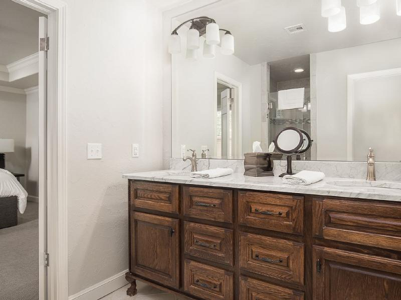 Master bath with a shower and 2 sinks.