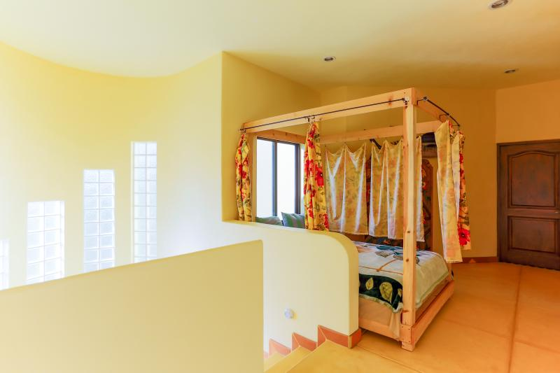 Queen size bed with privacy curtains, upstairs.