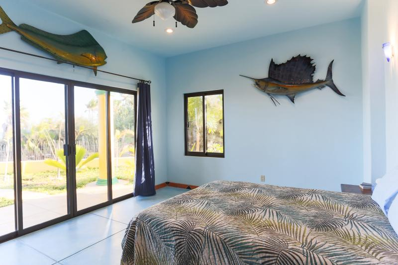 Downstairs bedroom with private patio, the Sailfish Room.