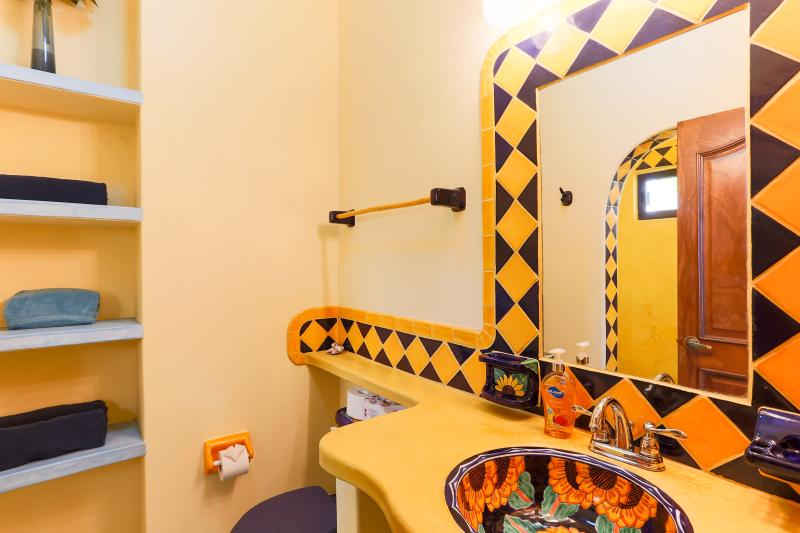 Downstairs bathroom with a sunflower theme.