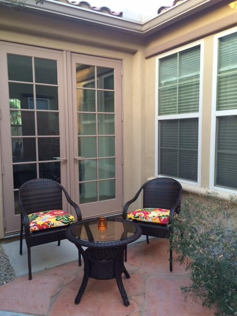 Small court yard patio with table and chairs added April 2016.