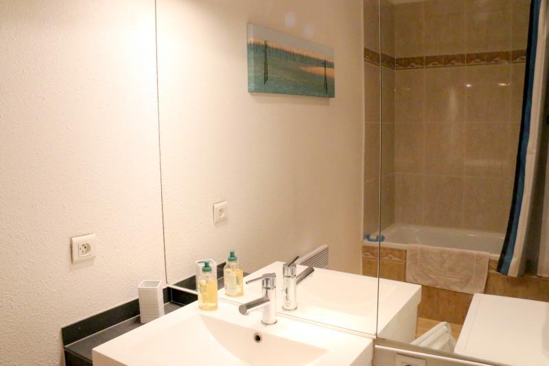 Bathroom has a bath, shower, and washing machine