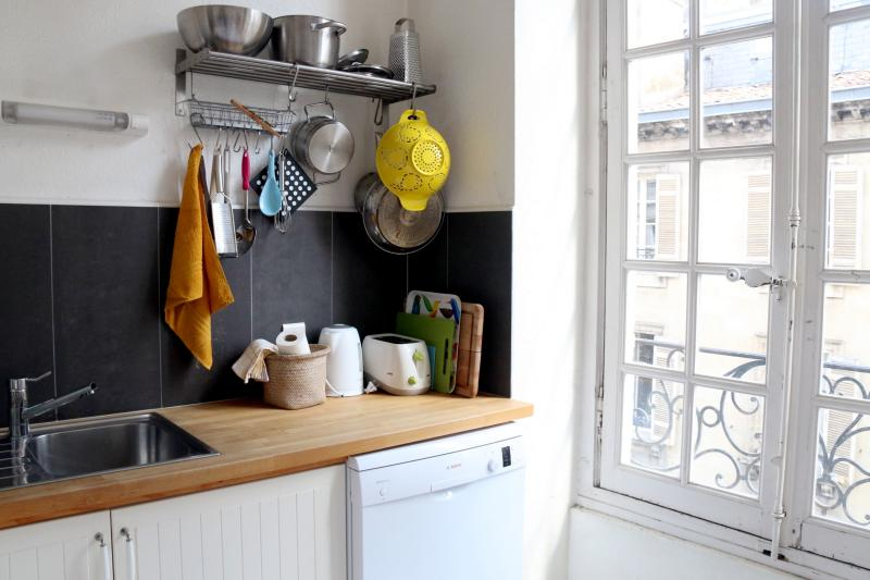 The kitchen has a dishwasher, stove, microwave and Nespresso machine