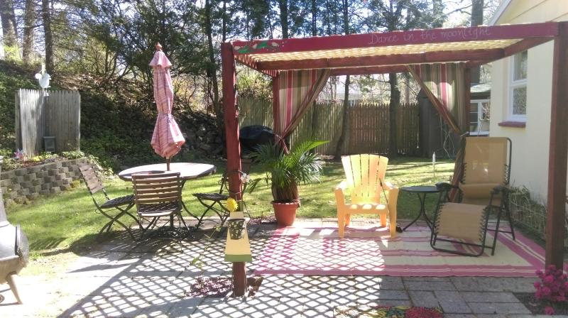 Relax in privacy on the acre treed lot. Pergola, chiminea & Grill--nap in a comfy hammock