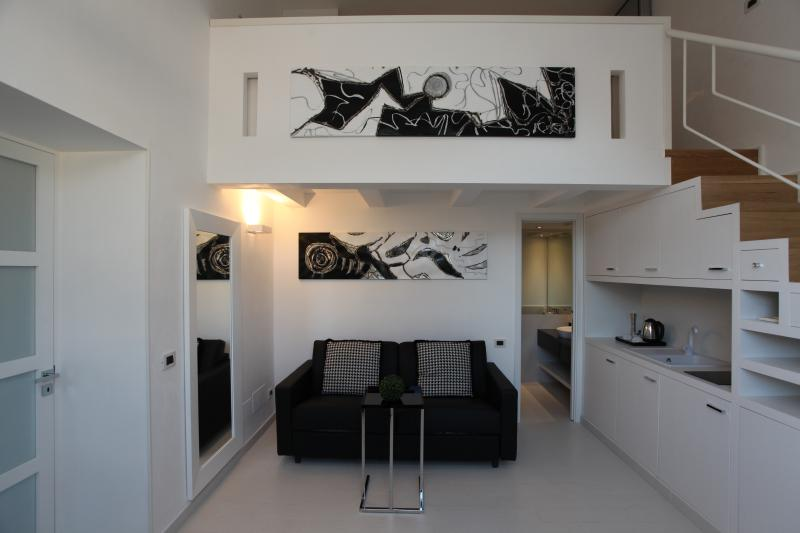 Welcome to Suite LHP Roma Piaza del Popolo. This is your living room