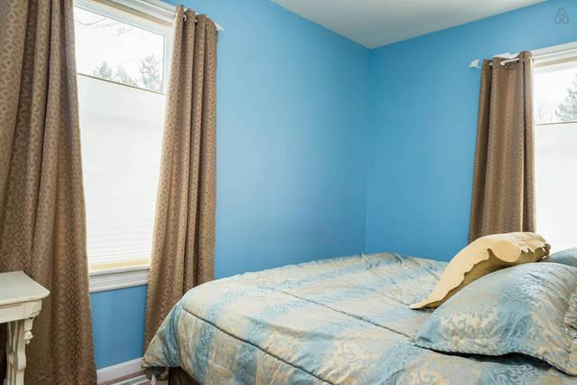 1st floor bright bedroom with king size bed.  Pull the drapes for a tranquil experience.