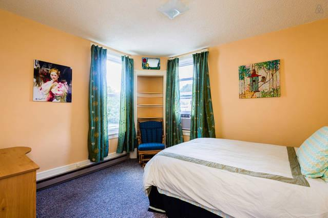 2nd floor -bedroom furnished with full size bed, rocking chair and desk