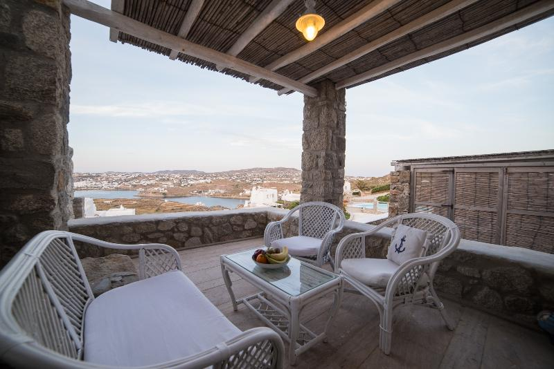 The terrace offers the best view at Mykonos town and Corfos