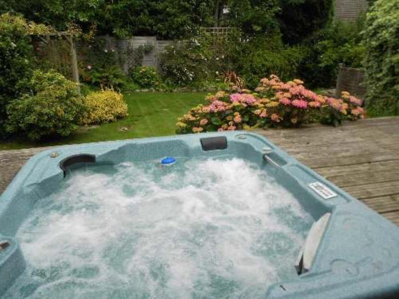 Rear garden, raised deck with inset 6 person hot tub.