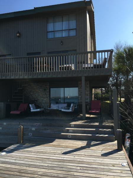 Rear view with dock and 2 patio decks.