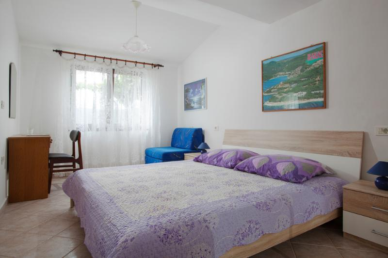 Bedroom in apartment 4 in house Smokovic