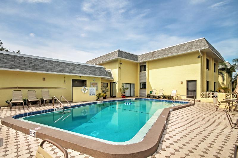 Lounge by the pool at this Sarasota vacation rental condo.