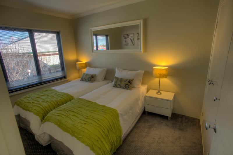 Third bedroom featuring adult single beds which can be placed together or seperated