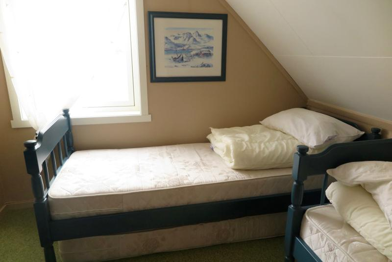 Three bedrooms (one double bed and seven single beds)