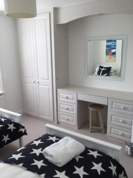 Bedroom 2 with many fitted wardrobes and dressing table