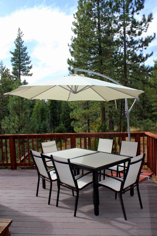 Upper Deck has outside dining , bbq grill and spa