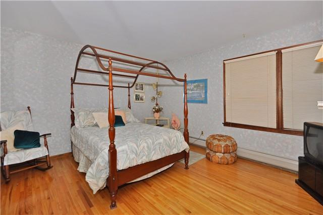 Guest room full size bed, dresser with mirror, rocking chair