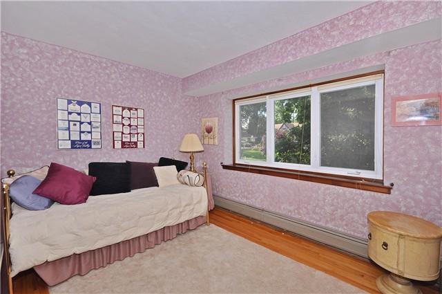 Guest room with day bed (2 twin beds), night stand, shelves built in closet
