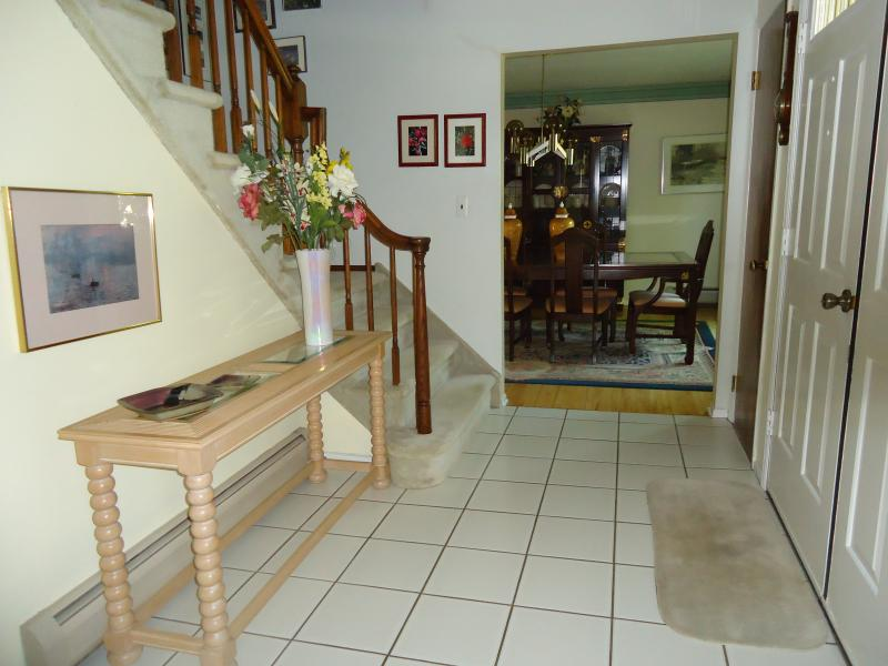 Foyer with 2 large coat closets on either side of front door