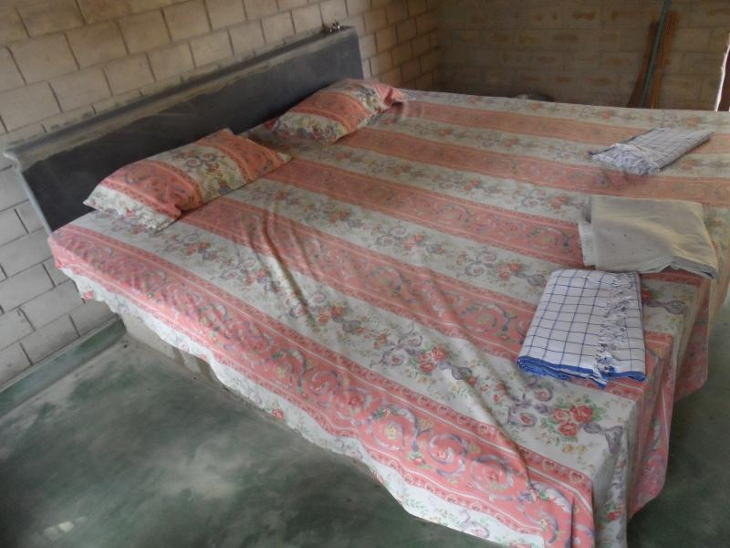 The bedroom has a double bed