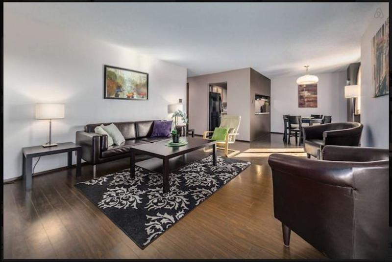 AMAZING CONDO OVERLOOKING 17 AVE! Very spacious, fully furnished with open floor plan!