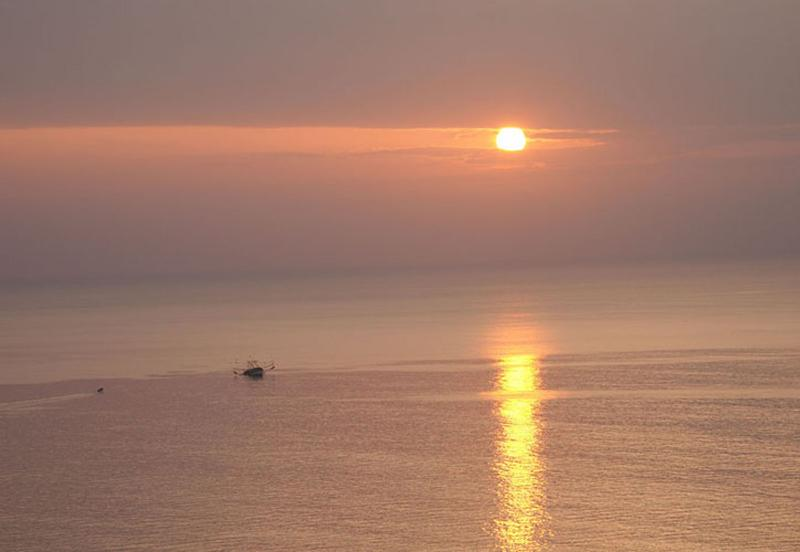Shrimp boat at dawn looking down from Playa Serena