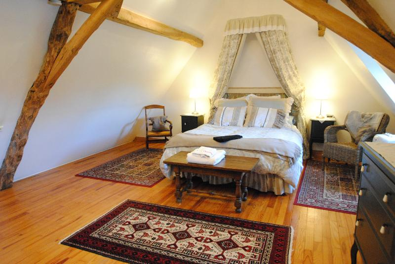 A romantic bedroom upstairs with good quality linen