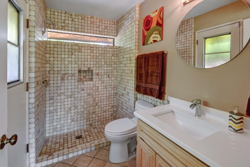 Third bathroom off of family room with direct outdoor and pool access.