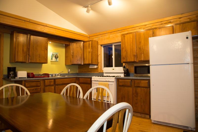 Full Kitchen.with full size fridge and freezer