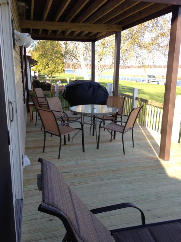 Covered area for eating and grilling.  Grill and utensils included.