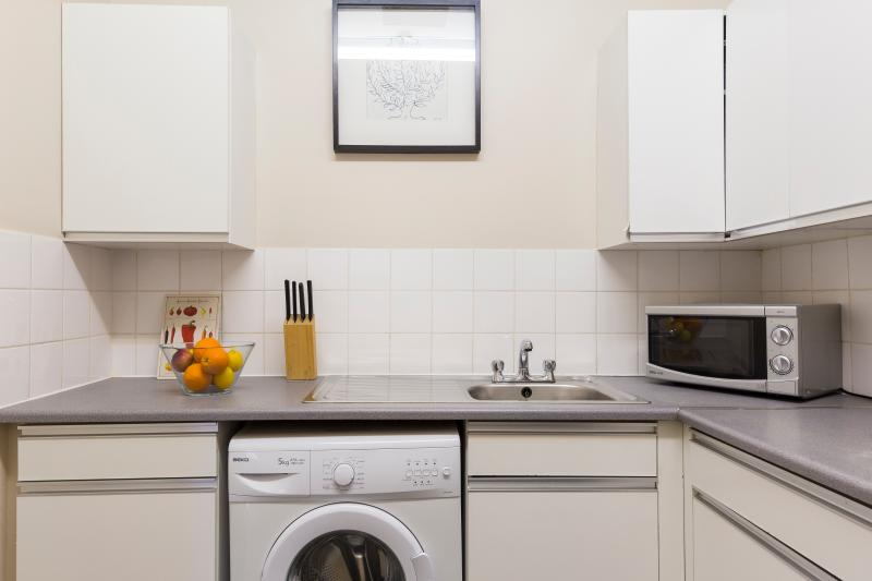 Fully equipped kitchen with all utensils, pans, plates etc Washing machine